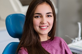 Young woman with braces in dental chair